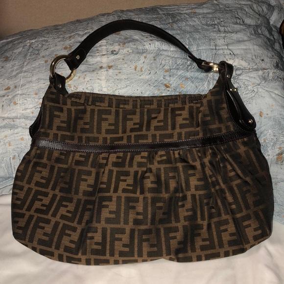 a04390e77b Tan and dark brown fendi bag, never used